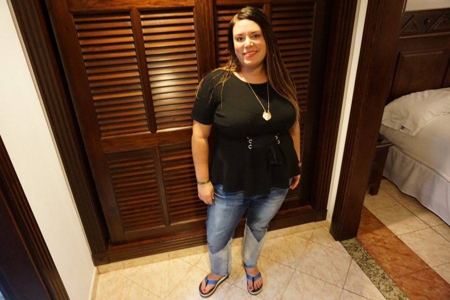 Alicia is pictured standing in front of a wooden closet door in the junior suites at Riu Palace Cabo San Lucas.