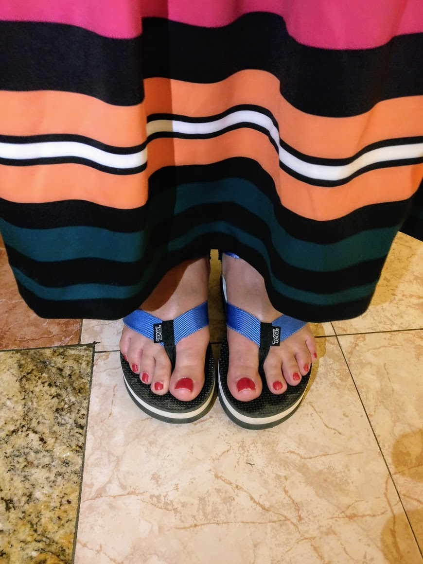 Alicia is at the Riu Palace Cabo San Lucas wearing a striped Eloquii mermaid skirt and TEVA flatform sandals.